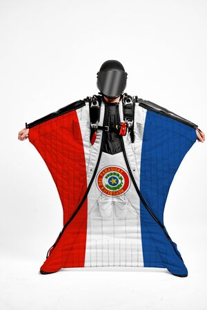 Paraguay extreme. Flag in skydiving. People in free fall grab flag of Paraguay. Patriotism, men and flag.