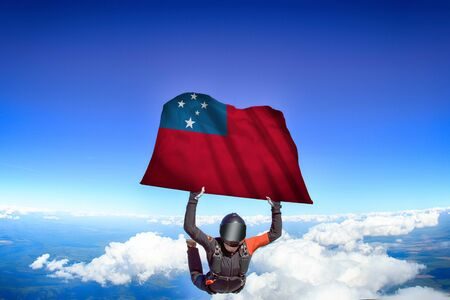 Samoa extreme. Flag in skydiving. People in free fall grab flag of Samoa. Patriotism, men and flag.