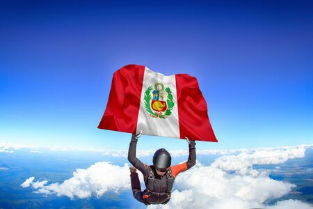 Peru extreme. Flag in skydiving. People in free fall grab flag of Peru. Patriotism, men and flag.