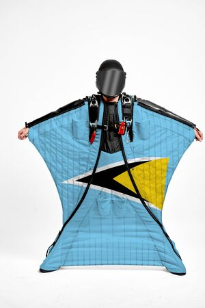 Saint Lucia extreme. Flag in skydiving. People in free fall grab flag of Saint Lucia. Patriotism, men and flag. 스톡 콘텐츠