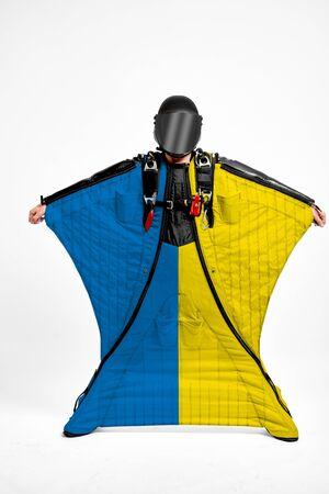 Ukraine extreme. Flag in skydiving. People in free fall grab flag of Ukraine. Patriotism, men and flag.