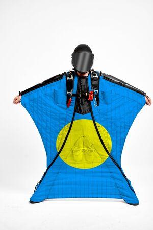 Palau extreme. Men in wing suit templet. Skydiving men in parashute. Simulator of free fall.