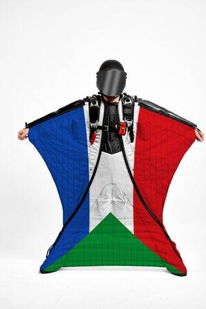 Sudan extreme. Men in wing suit templet. Skydiving men in parashute. Simulator of free fall.