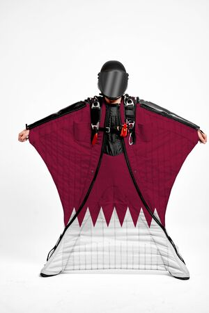 Qatar extreme. Men in wing suit templet. Skydiving men in parashute. Simulator of free fall.