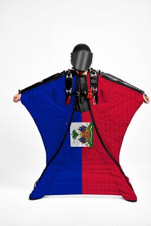 Haiti extreme. Men in wing suit templet. Skydiving men in parashute. Simulator of free fall.
