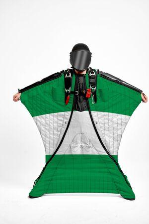 Nigeria extreme. Men in wing suit templet. Skydiving men in parashute. Simulator of free fall.