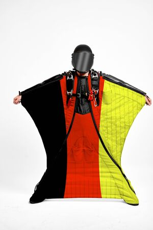 Germany extreme. Men in wing suit templet. Skydiving men in parashute. Simulator of free fall.