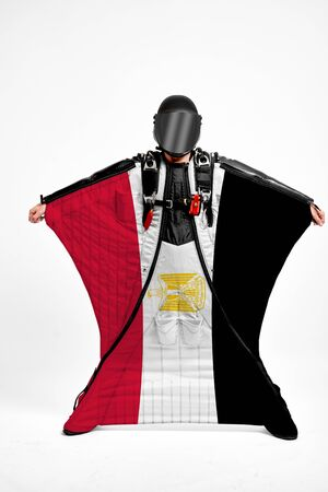Egypt extreme. Men in wing suit templet. Skydiving men in parashute. Simulator of free fall.