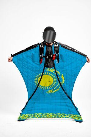 Kazakhstan extreme. Men in wing suit templet. Skydiving men in parashute. Simulator of free fall. Фото со стока