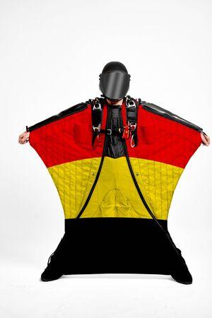 Belgium extreme. Men in wing suit templet. Skydiving men in parashute. Simulator of free fall.