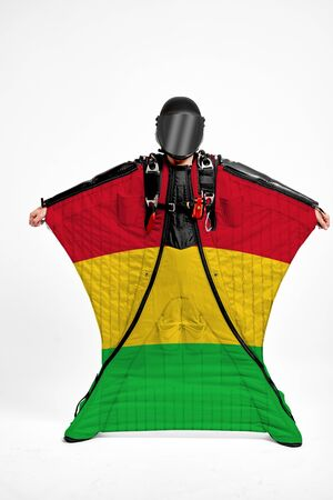 Mali extreme. Men in wing suit templet. Skydiving men in parashute. Simulator of free fall.
