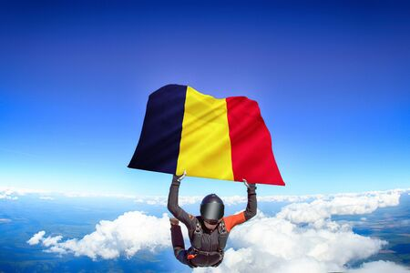 Chad extreme. Flag in skydiving. People in free fall grab flag of Chad. Patriotism, men and flag.