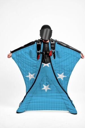 Federated States of Micronesia extreme.Men in wing suit templet. Skydiving men in parashute. Simulator of free fall. Фото со стока