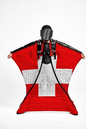 Switzerland extreme. Men in wing suit templet. Skydiving men in parashute. Simulator of free fall.