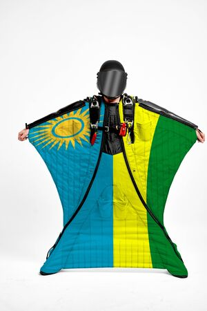 Rwanda extreme. Men in wing suit templet. Skydiving men in parashute. Simulator of free fall.