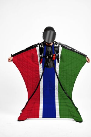 Gambia extreme. Men in wing suit templet. Skydiving men in parashute. Simulator of free fall. Фото со стока