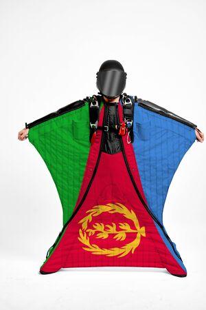 Eritrea extreme. Men in wing suit templet. Skydiving men in parashute. Simulator of free fall.