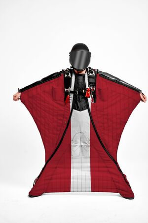 Latvia extreme. Men in wing suit templet. Skydiving men in parashute. Simulator of free fall.