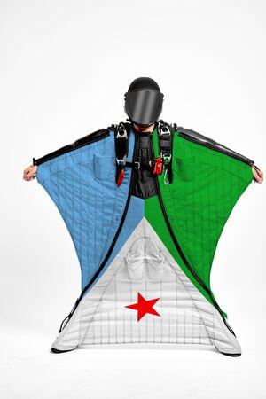Djibouti extreme. Men in wing suit templet. Skydiving men in parashute. Simulator of free fall.