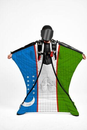 Uzbekistan extreme. Men in wing suit templet. Skydiving men in parashute. Simulator of free fall.