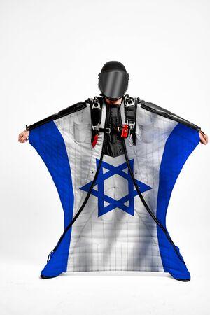 Israel extreme. Men in wing suit templet. Skydiving men in parashute. Simulator of free fall.