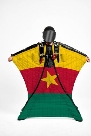 Cameroon extreme. Men in wing suit templet. Skydiving men in parashute. Simulator of free fall. Фото со стока