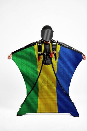 Gabon extreme. Men in wing suit templet. Skydiving men in parashute. Simulator of free fall.
