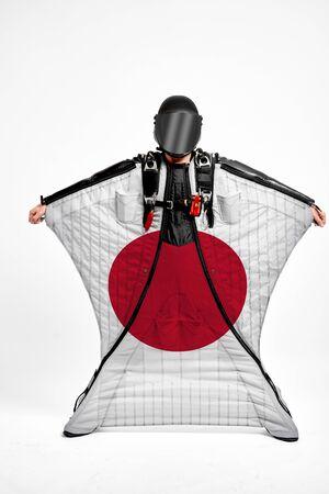 Japan extreme. Men in wing suit templet. Skydiving men in parashute. Simulator of free fall.