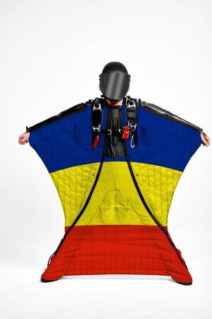 Romania extreme. Men in wing suit templet. Skydiving men in parashute. Simulator of free fall.
