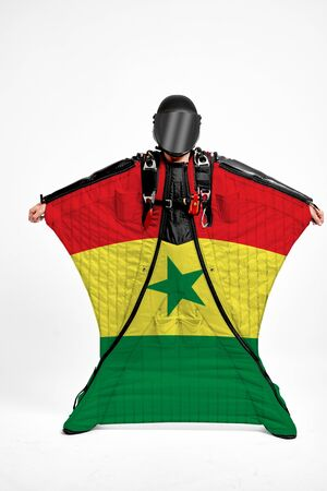 Senegal extreme. Men in wing suit templet. Skydiving men in parashute. Simulator of free fall. Фото со стока