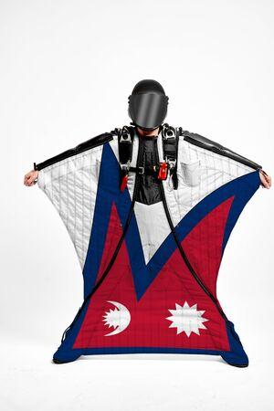Nepal flag travel. Men in wing suit templet. Skydiving men in parashute. Simulator of free fall.