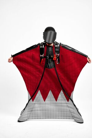 Bahrain extreme. Men in wing suit templet. Skydiving men in parashute. Simulator of free fall.
