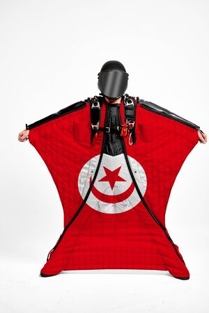 Tunisia extreme. Men in wing suit templet. Skydiving men in parashute. Simulator of free fall.