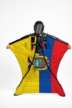 Ecuador extreme. Men in wing suit templet. Skydiving men in parashute. Simulator of free fall.