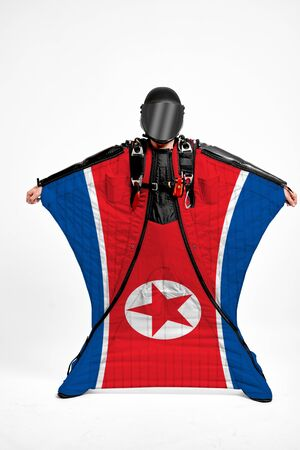 north korea extreme. Men in wing suit templet. Skydiving men in parashute. Simulator of free fall. Фото со стока