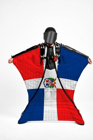 Dominican Republic extreme. Men in wing suit templet. Skydiving men in parashute. Simulator of free fall.
