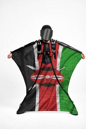 Kenya extreme. Men in wing suit templet. Skydiving men in parashute. Simulator of free fall.