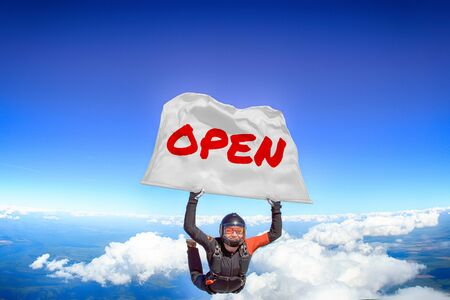 Open. Flag in skydiving. People in free fall.Teampleat skydiver. Extreme sport.