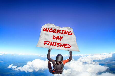 Working day finished. Men in parachute equipment. Skydiving sport. Extreme hobby as a way of life. Parachuting. Men in free fall.