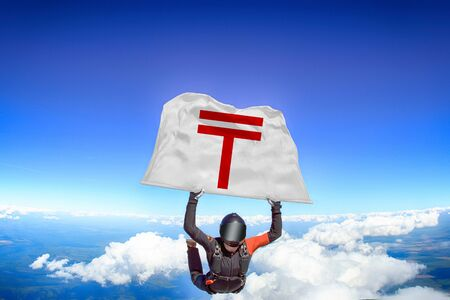 Tenge. Men in parachute equipment. Skydiving sport. Extreme hobby as a way of life. Parachuting. Men in free fall.