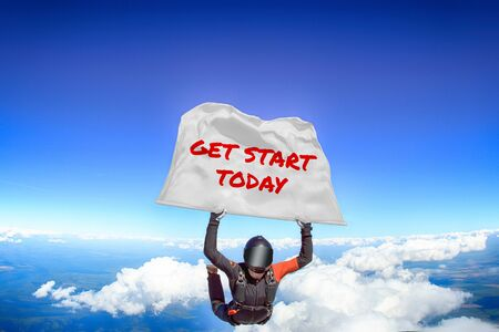Get start today. Men in parachute equipment. Skydiving sport. Extreme hobby as a way of life. Parachuting. Men in free fall.