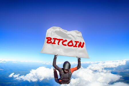 Bitcoin. Men in parachute equipment. Skydiving sport. Extreme hobby as a way of life. Parachuting. Men in free fall.