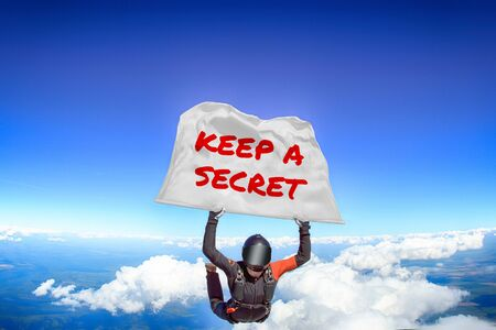 Keep a secret. Men in parachute equipment. Skydiving sport. Extreme hobby as a way of life. Parachuting. Men in free fall. Zdjęcie Seryjne
