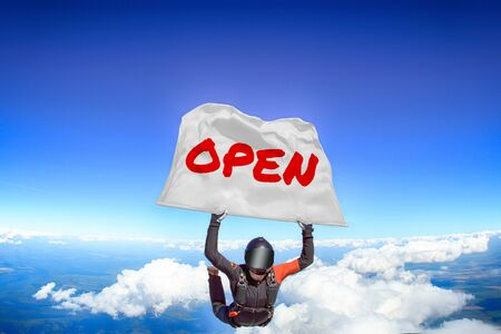 Open. Men in parachute equipment. Skydiving sport. Extreme hobby as a way of life. Parachuting. Men in free fall.