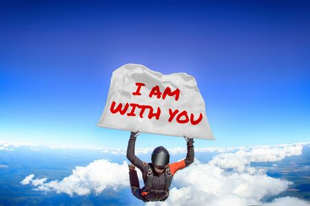 I am with you. Men in parachute equipment. Skydiving sport. Extreme hobby as a way of life. Parachuting. Men in free fall.