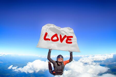 Love. Flag in skydiving. People in free fall.Teampleat skydiver. Extreme sport.