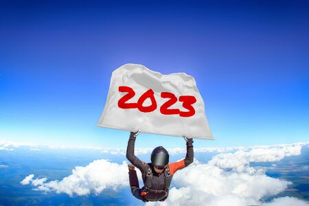 2023. Men in parachute equipment. Skydiving sport. Extreme hobby as a way of life. Parachuting. Men in free fall.