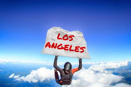 Los Angeles. Men in parachute equipment. Skydiving sport. Extreme hobby as a way of life. Parachuting. Men in free fall. Zdjęcie Seryjne