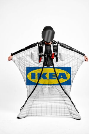 IKEA. Men in wing suit demonstrations popular brands. Men simulates of free fall.