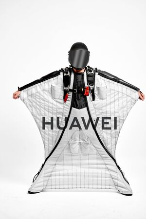 Huawei. Men in wing suit demonstrations popular brands. Men simulates of free fall.